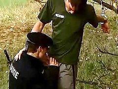 Policeman sucking convict in nature
