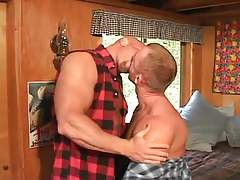 Horny gay guys giving a kiss in mattress