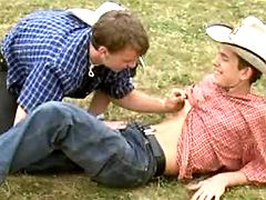 Adorable lil cowboys enjoy oral caresses on grass